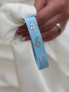 Sew a blue ribbon inside the dress with your wedding date embroidered on it. What a great idea for your something blue!