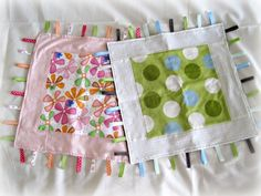 Taggie blankets.  So easy and so cute!  Varying the ribbons more makes this even more fun.  I like to throw a bit of ric rac in there.