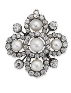 A late Victorian diamond and pearl brooch/pendant Of cluster design, set centrally with a pearl, measuring approxi 6.77mm, the lobed surround set throughout with old round brilliant-cut diamonds and a further four pearls, measuring approx 5.49 - 5.90mm, with detachable brooch fitting, pendant bale lacking, mounted in silver on gold, width 30mm, the diamonds estimated to weigh approximately 2.50cts in total.