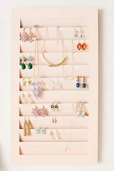 Use a vintage shutter to display earrings