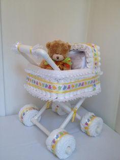 http://www.pinterest.com/loveableeve/baby-showers/  diaper stroller: