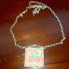 """Love Necklace Vintage style pendant with love in the front and leopard print on the back. Chain is 32"""". Jewelry Necklaces"""