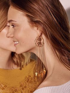 Time to shine – light up the room this festive season by pairing statement earrings with cashmere knits