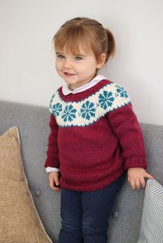 Litla Blóm is a pretty winter sweater with a fair-isle yoke. The sleeves are knitted in the round in stockinette stitch, and are then attached to the body.