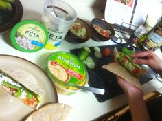 Hannah Beaver (long time company member of Alpha - now rehearsal assistant and teacher for BMag) puts together an easy meal that is healthy and filling. Even her husband likes it and is full after eating.   Vegetable hummus Pita pockets with Greek inspired side salad.   Pita pockets (whole wheat) with roasted red pepper hummus, feta cheese, spinach, green olives, cucumber, green pepper and tomato.  (also like to add sprouts, avocado, and spinach).   Side salad - tomatoes, green olives…