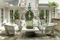 Clean and Casual - These Porches Got a Merry Makeover for the Holidays - Southernliving. Fresh colors are given a seasonal upgrade with pops of classic Christmas greenery. Ornaments add easy charm to the year-round centerpiece.