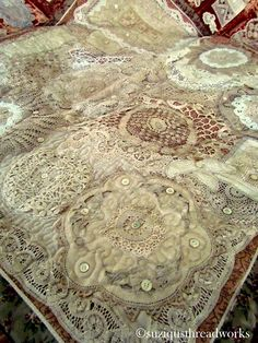 Suziqu's Threadworks quilt made out of doilies and velvet. Wow!.