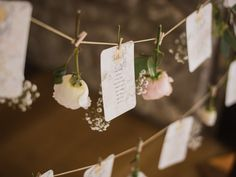 Strung up Table Plan with Rose Flower Heads | Elegant Wedding At Priston Mill | Bride in Suzanne Neville Gown | Stephanie Browne Statement Necklace | Bridesmaids In Lilac Coast Dresses | Images by John Barwood Photography | http://www.rockmywedding.co.uk/lisa-ross/