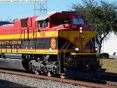 Kansas City Southern [KCS] Engine No. 4136 leading a military transport train east on the P Sub