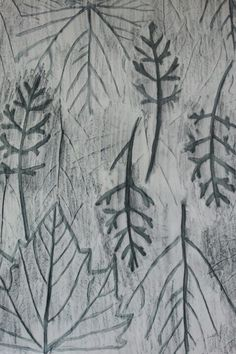 Leaves were placed under the paper and their shapes were transferred by rubbing a watercolor pencil over the page. The lines were wet in order to make them stand out.