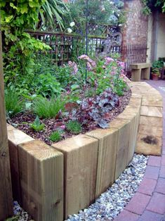 use vertical railway sleepers to create a curved wall raised beds - curved walls may work with overall design better divide between Mediterranean garden and English garden rather than original oblong med wall bed idea garden raised beds Small Front Gardens, Back Gardens, Outdoor Gardens, Lawn And Landscape, Landscape Edging, Garden Cottage, Garden Beds, Sloped Garden, Garden Posts