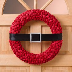 What a jolly way to greet #Christmas guests! This Santa wreath is a cinch to #DIY.