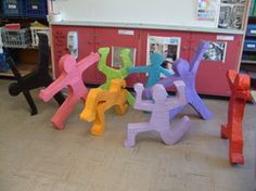 7th Grade Keith Haring Sculptures. Installation. Have to do this at school! This could solve the no art in the hallways/walls because of fire restrictions problem!!