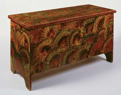 New England Grain Painted Dower chest c. 1830, this fantastic and colorful pattern was created through the application of pigment dissolved in water, turpentine, or vinegar,which was then manipulated while wet using a variety of tools or textured materials such as brushes, combs, lether, or putty.  In this example, the artist's hand is literally visible in the repeated pattern of overlapping fans.  The technique is traditional, the result unique.  22 H. x 41.25 W. x 18.5 D.