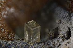 Phosgenite,  Pb2(CO3)Cl2, Vrissaki slag Fund office , Lavrion , Attica, Greece. Size 0.3 mm. Copyright derhesse