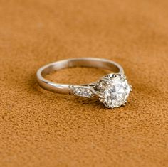 A beautiful vintage crown mounting solitaire engagement ring with a stunning old European cut diamond in the center.