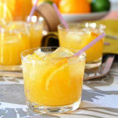 sunshine dazzler--vodka, oj, mango juice and champagne - early football game necessity