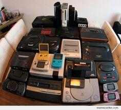 Nice Collection someone has here. I (Holly) can name them all: : X-Box, PlayStation 3, X-Box 360, Gamecube, Atari 2600, Sega Saturn, Sega Master System, Sega Genesis (Mega Drive) with Sega CD attachment, Super NES (PAL version), Sega Master System II, Neo-Geo, Sega Genesis/ MegaDrive (PAL Version), GBA (Glacier), GBA (Pink), PlayStation, NDS Lite, NES, Neo-Geo Pocket, GBC, GBA-SP, Nintendo 64, Sega Game Gear, Atari Lynx, and Atari 7800.