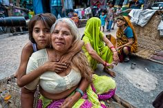 Photograph Young Indian girl hugs woman by Damon Lynch on 500px