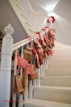 Our advent calendar 48 little packages on our beautiful white banister