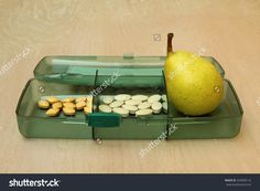 Vitamins pack - royalty free stock photo. Buy high resolution image on Shutterstock: http://www.shutterstock.com/pic-324900116/stock-photo-pear-in-a-pack-of-vitamins-on-a-wooden-table.html?src=zYkefZGtzG9ofJafugw6hA-1-35?rid=987479