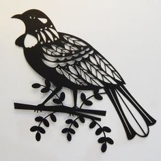 This New Zealand Tui bird has been cut out of firm black paper using my amazing cuttting machine. (I design it it, cuts it for me!) I have included removable adhesive so you can very easily decorate your wall. I love the way a subtle shadow is created. I have sold these to customers who frame them too! The Tui is about A4/ 8 x 10 inches in size, it looks great with the Fantail papercut too