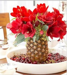 Centerpiece♥ Amaryllis in a Pineapple Vase  I love this idea for summer!!