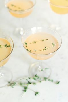 This Bruleed Grapefruit and Gin Fizz is a beautiful and tasty signature cocktail recipe to greet your New Year's Eve guests with!