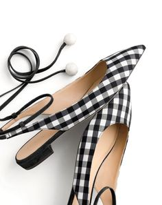 """Meet Lily, our newest J.Crew slingback style, made in Italy in gingham, with polished pom-pom ties. What's the Italian for """"love at first sight""""?"""