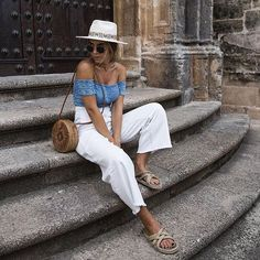 Chic Casual Bright Blue Off The Shoulder Crop Top Paired With White Linen High Waisted Summer Pants And Nomadic State Of Mind Beige Woven Braided Slide On Flat Sandals Mexico Vacation Outfits, Summer Vacation Outfits, Travel Outfit Summer, Europe Outfits, Italy Outfits, Summer Pants Outfits, Outfits With Hats, Summer Shoes, Barcelona Outfit