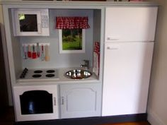 An old TV entertainment center turned into a dream play kitchen. Absolute genius!