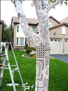 This one is almost elegant - done in tablecloths and doilies - covering a mannequin or chair to elevate the window status