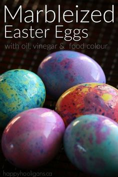 Marbleized Easter Eggs with vinegar, oil and food colouring. A stunning effect for homemade dyed eggs!  Great Easter activity for kids or grown-ups!  Happy Hooligans