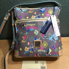 """NWT Disney Dooney and Bourke half marathon purse coated canvas exterior depth: 4""""  length: 10"""" height: 10.25""""  grey with mickey and friends dooney and bourke metal plaque exterior front zip pocket  top zip closure leather buckle shoulder strap 10"""" strap drop attachable, detachable leather buckle strap to transform into cross body 26"""" strap drop interior zip pocket, 3 slip pockets and key hook leash dooney and disney park tags inside registration/warranty card included blue fabric interior…"""