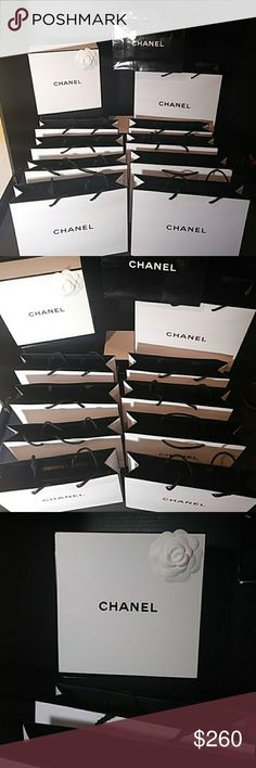 CHANEL One Chanel box.  10 Chanel shopping bags.  Nine white bags and one black bag.  Great for giving gifts during the holidays. CHANEL Makeup