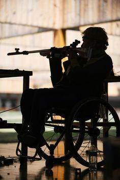 A player on wheelchair competes in the men's 50m rifle 3 positions SH1 on day 5 of the Rio 2016 Paralympic Games at Olympic shooting centre on September 12, 2016 in Rio de Janeiro, Brazil.