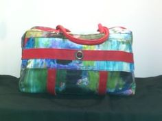 poshvero.com    This great bag by Aventures des Toiles is perfect for traveling.