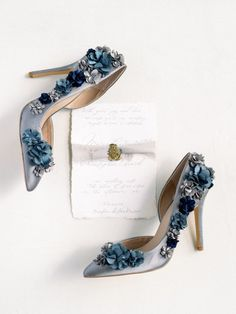 9 Timeless Wedding Color Palettes That Work for Every Season and Theme - There are certain color palettes that look beautiful at any wedding, no matter the time of year, theme, or decade—and these timeless wedding colors are a good place to start. blue, shoes, flowers, satin {Script Me Pretty}