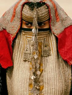 Africa | Rashaida Bride, Eritrea.  Photograph by Carol Beckwith and Angela Fisher  Veiled behind an elaborate mask called a burga, a Rashaida bride stays in seclusion before her wedding. The Muslim Rashaida are Bedouin merchants and camel breeders, originally from Saudi Arabia, who keep to themselves and marry only their own.