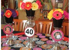 40th Birthday fun.   Old pictures and new gerber daisies really makes a pretty table.