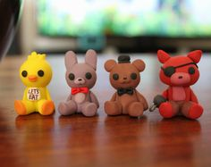 Can you survive the full 5 nights at Freddy Fazbears Pizzeria? Handmade figures from polymer clay, in my own unique style. Each are sized approximately 3.5cm tall.  My creations are 100% clay, no painting involved! As they are handmade, each piece is unique and please note that they are still a little fragile! Each of my figures are made to order and take me within 1-3 weeks to complete.   *Five Nights at Freddys franchise is owned by Scott Cawthon*