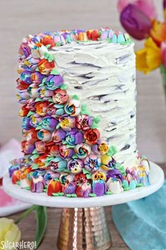 Spring In Bloom Layer Cake - an extra-tall cake COVERED in gorgeous buttercream flowers! | From SugarHero.com