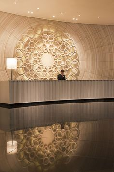 round sculptural reception desk at hotel - Google Search