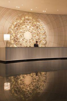 round sculptural reception desk at hotel - Google Search
