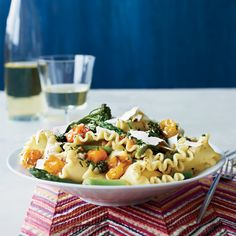 Star chef Mario Batali's vegetable pasta combines oven-roasted cherry tomatoes with asparagus, Broccolini and shaved ricotta salata cheese.