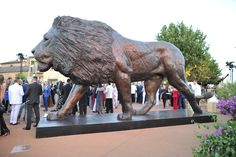 Dawn Patrol Monumental - Bronze Sculpture by Bruce Little. Here the piece is on display at the 2016 Leonardo DiCaprio Foundation Auction in St Tropez. The sculpture fetched an auction bid of USD1 Million, all of which was donated to the Foundation which supports various environmental causes Bronze Sculpture, Lion Sculpture, Leonardo Dicaprio Foundation, Auction Bid, Dawn, Display, Statue, Floor Space, Billboard