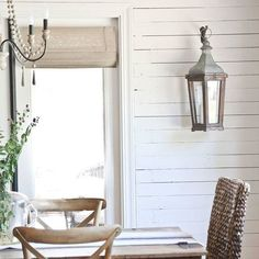 Adding a Park Hill Lantern is a lovely way to add candle light to a dining room