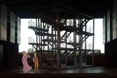 The mobile metal scaffoldings in Ost's design stand in for the cityscape and also support screens for the production's video projections. Set Design Theatre, Theatre Geek, Theatre Stage, Prop Design, Stage Design, Design Model, Jesus Christ Superstar, Stage Set, Scenic Design