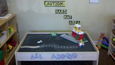 i painted the table top to my classroom toy car table with chalk board paint, so now the kidos can draw on their own roads and train tracks. super fun for them.