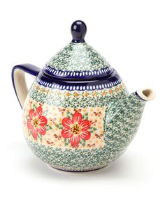 Durable, beautiful and functional, this heirloom-quality teapot is handmade and hand-painted in Poland with signature patterns, so it's guaranteed to be stunningly unique. Perfect for a tea party, it can serve as a decorating statement when not in use.7'' W x 9'' H x 6'' DStonewareMicrowave, dishwasher and freezer safeMade in Poland